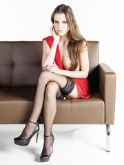elegant lady posing on armchair