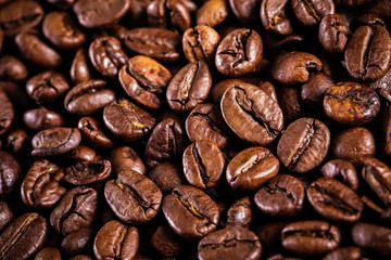 roasted coffee beans background. brown texture