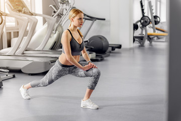 Serene woman doing workout in gym