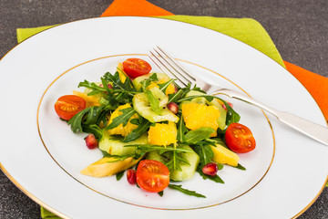 Fruit and vegetable salad with arugula