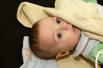 Baby boy playing with towel