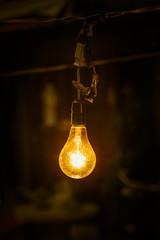 lighting hang tungsten light bulb at night.