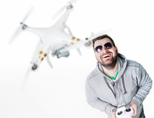 Cheerful man controlling a drone