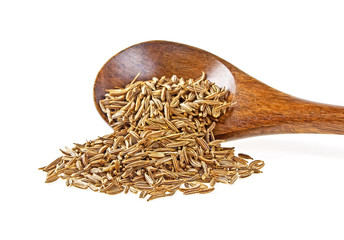 Cumin seeds in wooden spoon on a white background