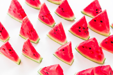 Slices of juicy watermelon on white background. Flat lay. Top view. Summer pattern