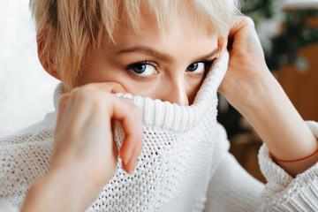 blonde young woman wearing sweater