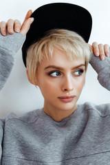 Hipster teen girl in black cap