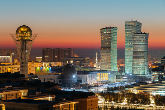 Top view of the Baiterek Monument and the Northern Lights complex on the evening of a winter sunset day in Astana, Kazakhstan