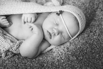 Sleeping newborn baby girl.