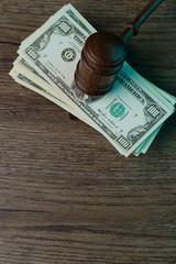 Judge's hammer lies on bills