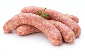Raw sausage with parsley leaf isolated on white background.