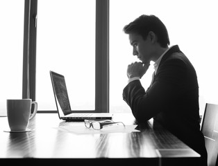 Businessman woking on his laptop computer.