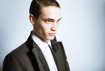 Portrait of male fashion model posing in suit.
