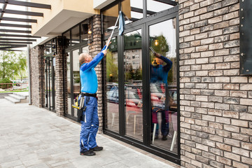 window washer working  at building outdoor