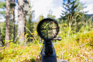 Sniper gun scope view.