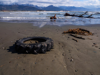 Tractor wheel abandoned along the beach