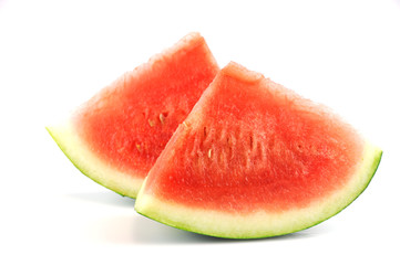 sliced fresh seedless watermelon isolated on white background