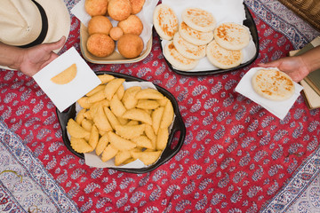 summer day picnic blanket - empanadas, arepas  and bunuelos - traditional southamerican food