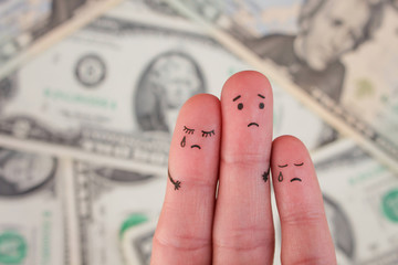 Finger art of displeased family on background of money. Concept of poor people.