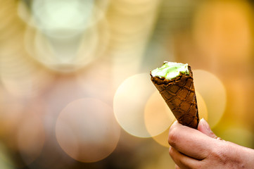 photo of woman's hand hold ice cream, mean for sharing something to another one