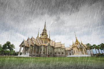 Garden Poster Temple Wat Luang Pho Toh temple with falling rain in Nakhon Ratchasima, Thailand