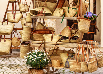 Shopping for straw bags in Palma de Mallorca, Balearic Islands, Spain