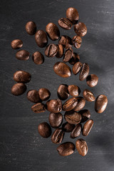 Flying coffee beans isolated on dark background