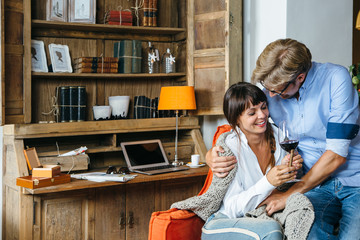 Joyful spouses spending time at home