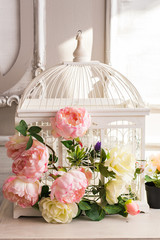 Shabby chic decoration with beautiful vintage birdcage and flowers