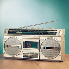 Retro radio recorder from 70s front turquoise background. Old style filtered photo