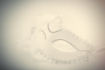 photo of beautiful masquerade mask on the wonderful white studio background