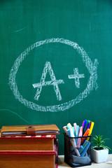 chalk board draw A plus grad mark