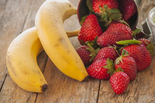 strawberry banana fruits on wood table