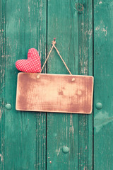 Love heart, sign board on vintage wooden background
