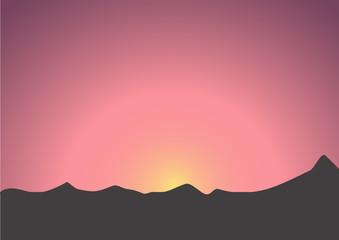 Beautiful sunrise over the dark mountains