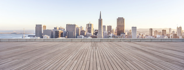 empty wooden floor with cityscape of modern city