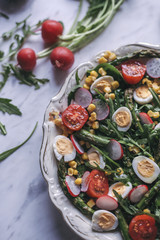 Green salad with roasted asparagus and quail eggs