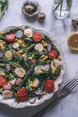 Green salad with roasted asparagus and quail eggs
