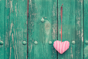 Valentine love heart on wooden wall background