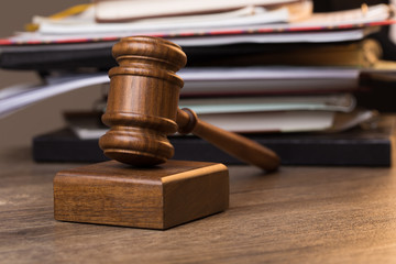 Documents, judge's hammer on table
