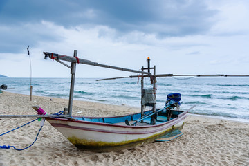 Fishing boats on the beach over cloudy sky at Prachuap Khiri Khan, Thailand.