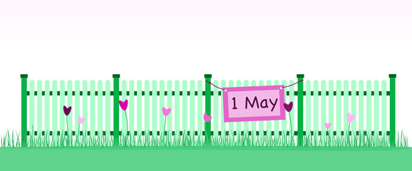 First May. Celebration of the First of May. Fence with flowers in green landscape. Sign with text : 1 May.
