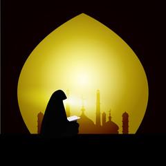 Muslim woman reading Quran on sunset  background
