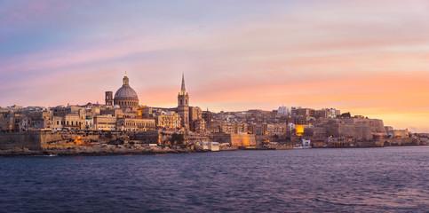 Valletta skyline at sunset viewed from Sliema, Malta
