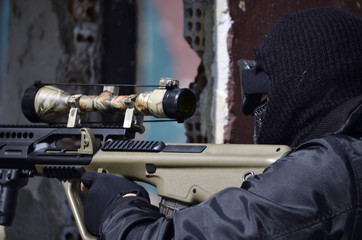 Sniper aim target with scope, black mask gloves and black uniform