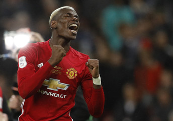 Manchester United's Paul Pogba celebrates at the end of the match