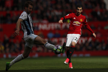Manchester United's Henrikh Mkhitaryan in action with West Bromwich Albion's Craig Dawson