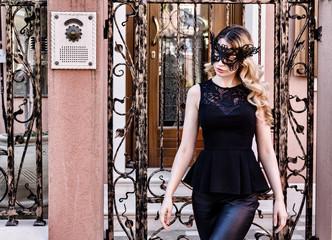 Girl wearing a black mask in Burano Island, Italy