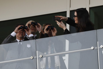 Actress Liv Tyler takes a picture of fiance Dave Gardner (L) during the 2.50 Coral Cup Handicap Hurdle