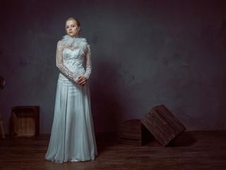 Tall blonde girl posing in elegant wedding dresses.